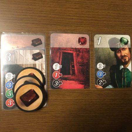 手札の状況は、黒カード2枚、赤カード1枚、緑カード1枚、黒宝石3枚。